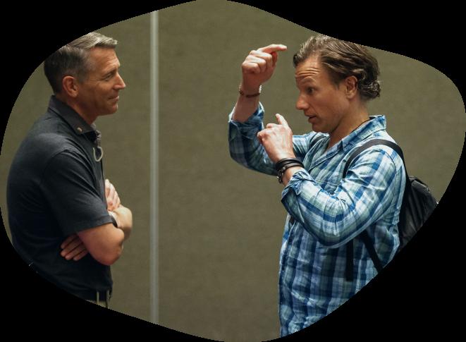 TMYD CEO Dane Sanders conversing with a team member